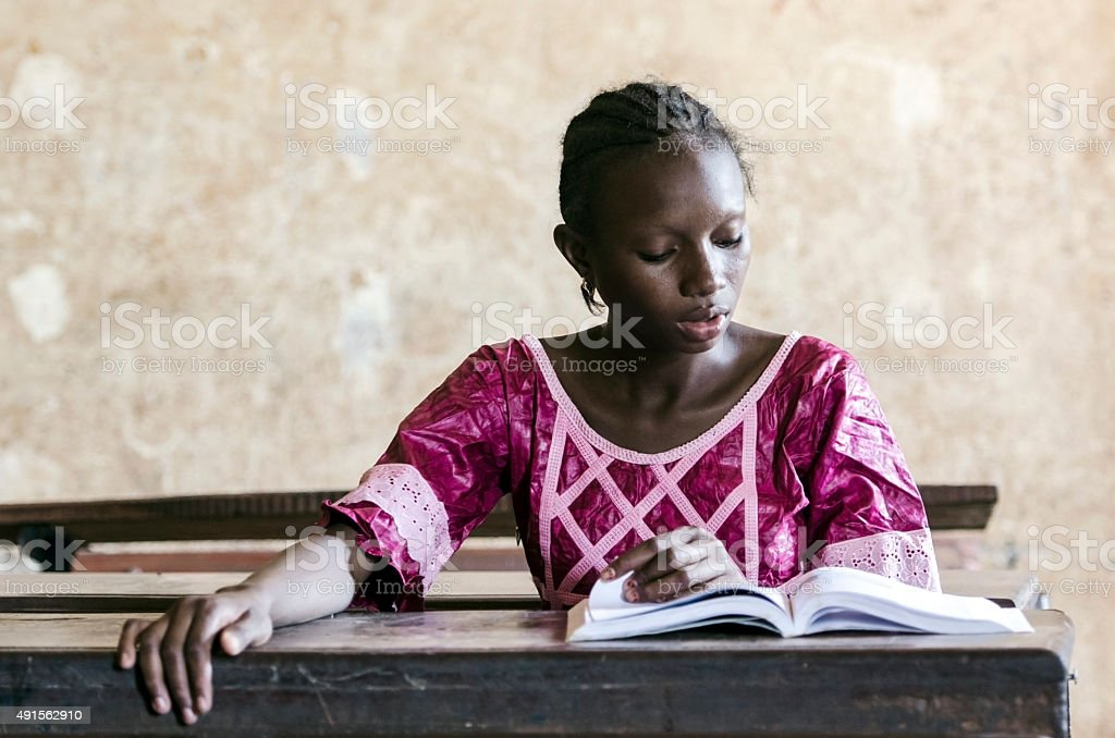 Learning Activity Symbol: Young Black Child Reading a Book stock photo