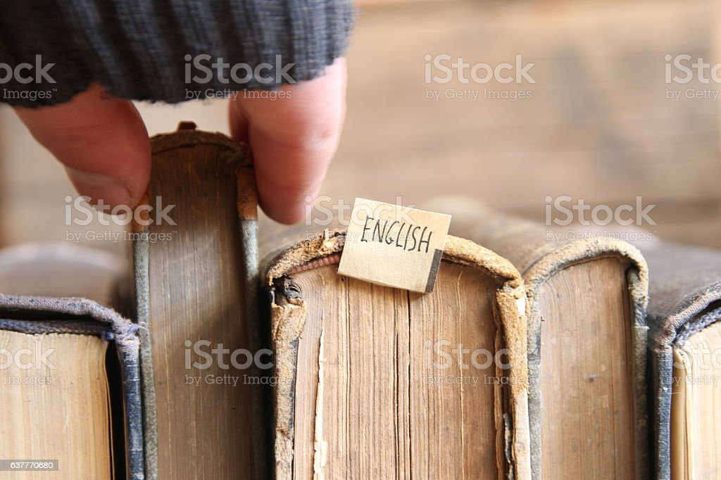 Learning english concept, tag and vintage books, soft focus. Toned. stock photo