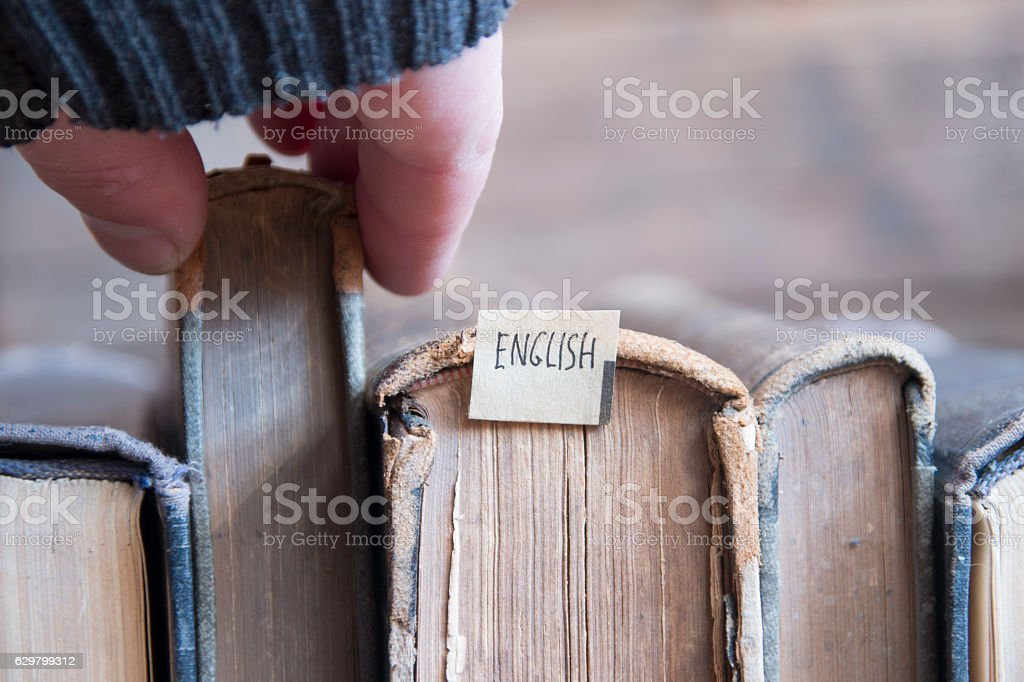 Learning english, education concept, tag and vintage books, soft focus stock photo