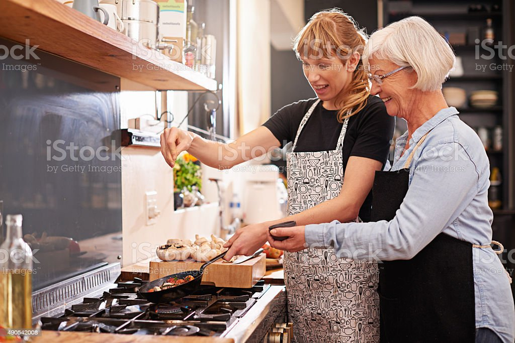 Learning from master chef stock photo