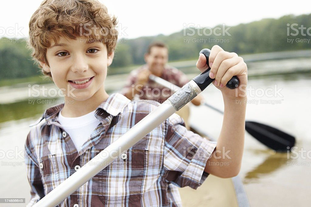 Learning how to canoe with dad royalty-free stock photo