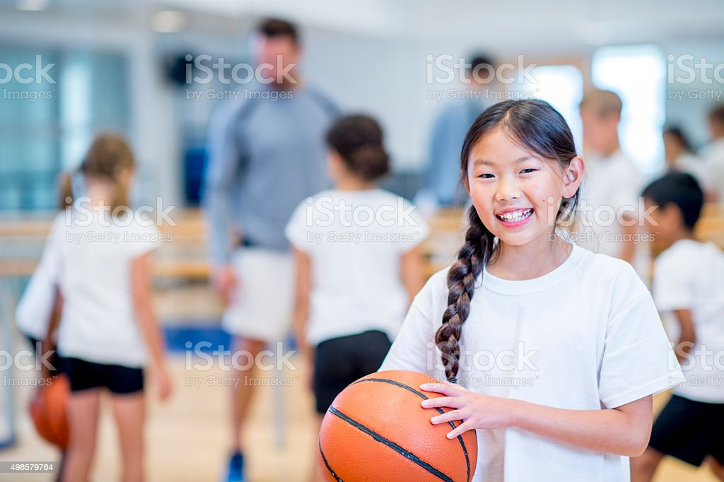 Learning How to Dribble in Class stock photo