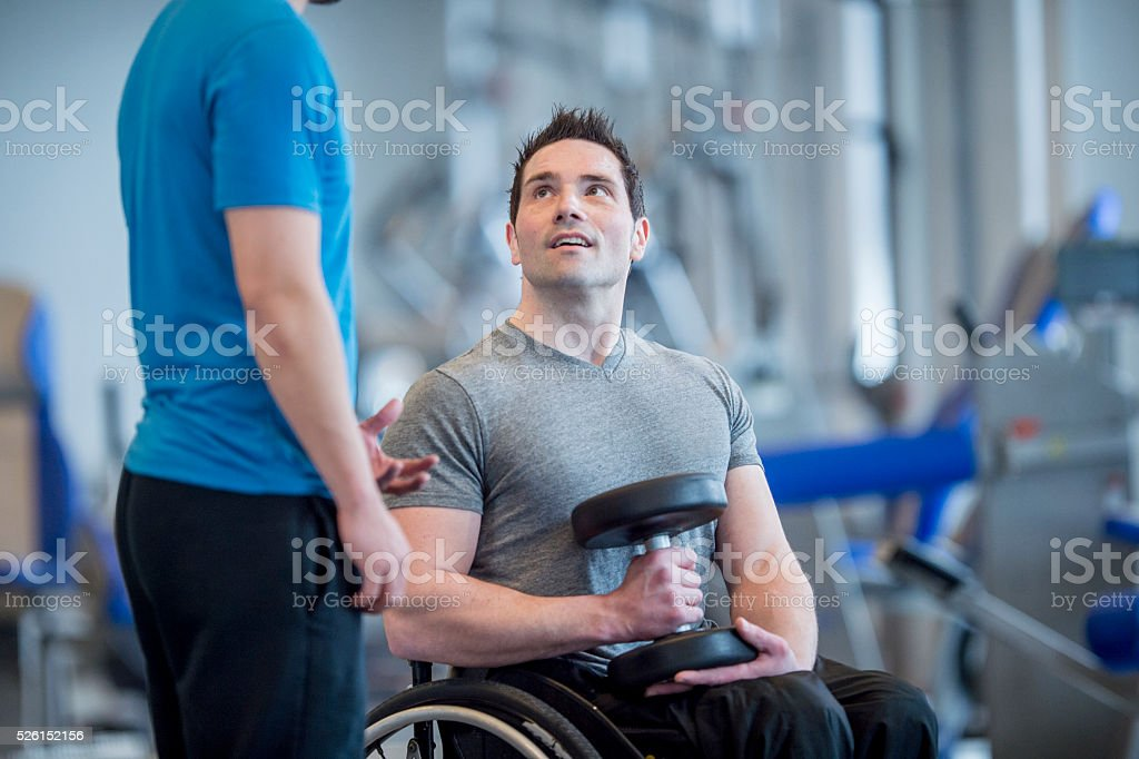 Learning How to Lift Weights with an Injury stock photo