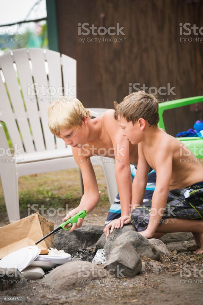 Learning how to make a campfire stock photo