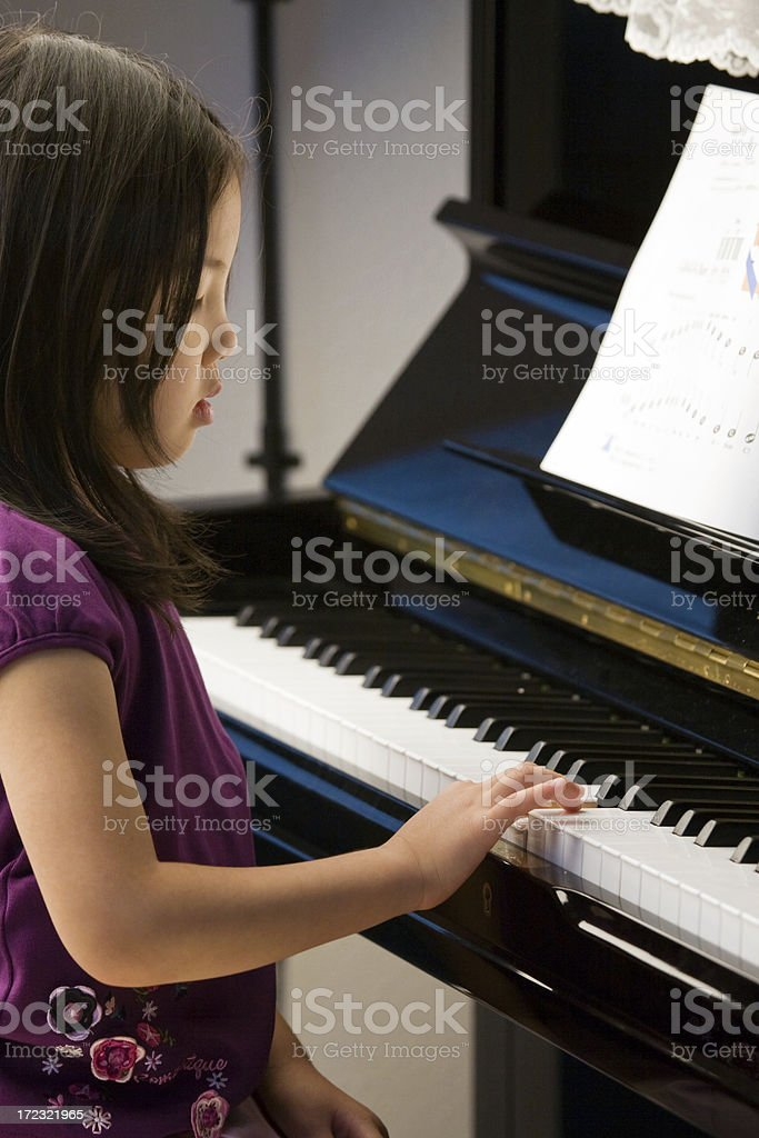 Learning How to Play Piano royalty-free stock photo