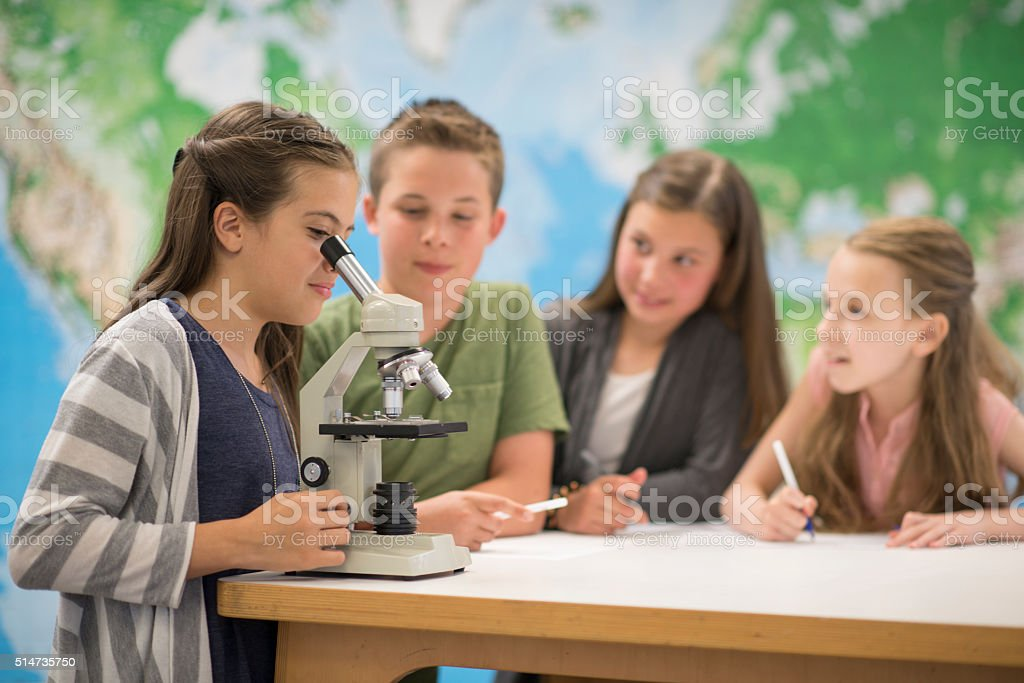 Learning How to Use a Micsroscope stock photo