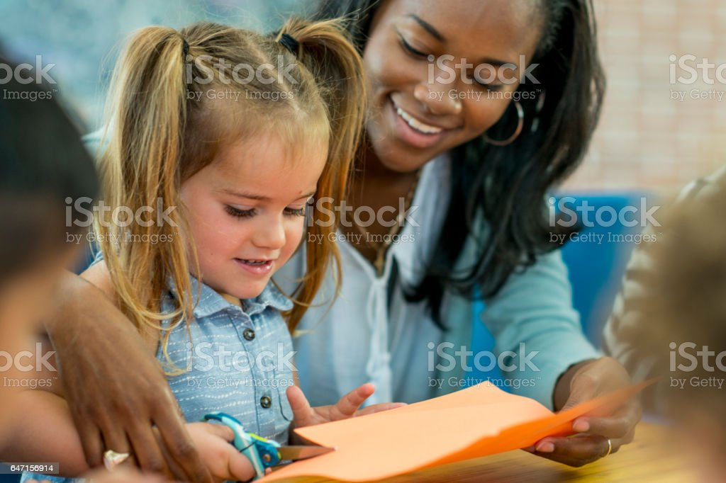 Learning How to Use Scissors stock photo