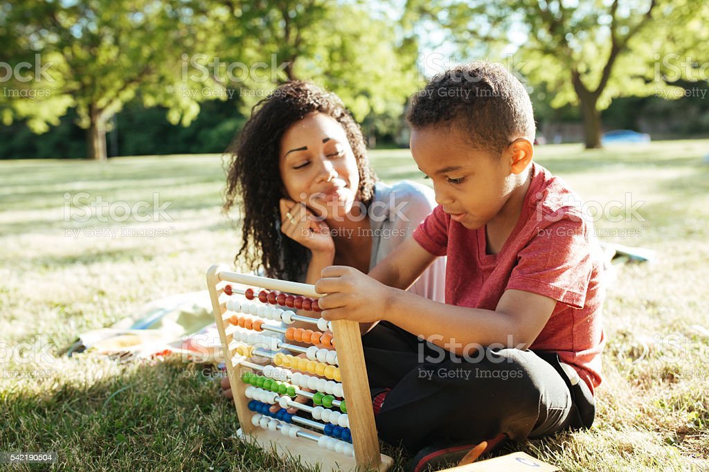 Learning on picnic stock photo