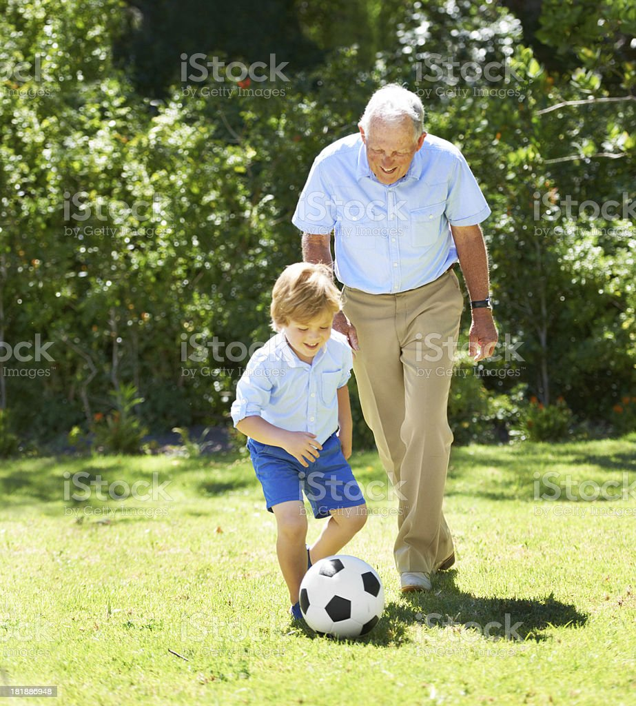 Learning some soccer skills from grandpa royalty-free stock photo