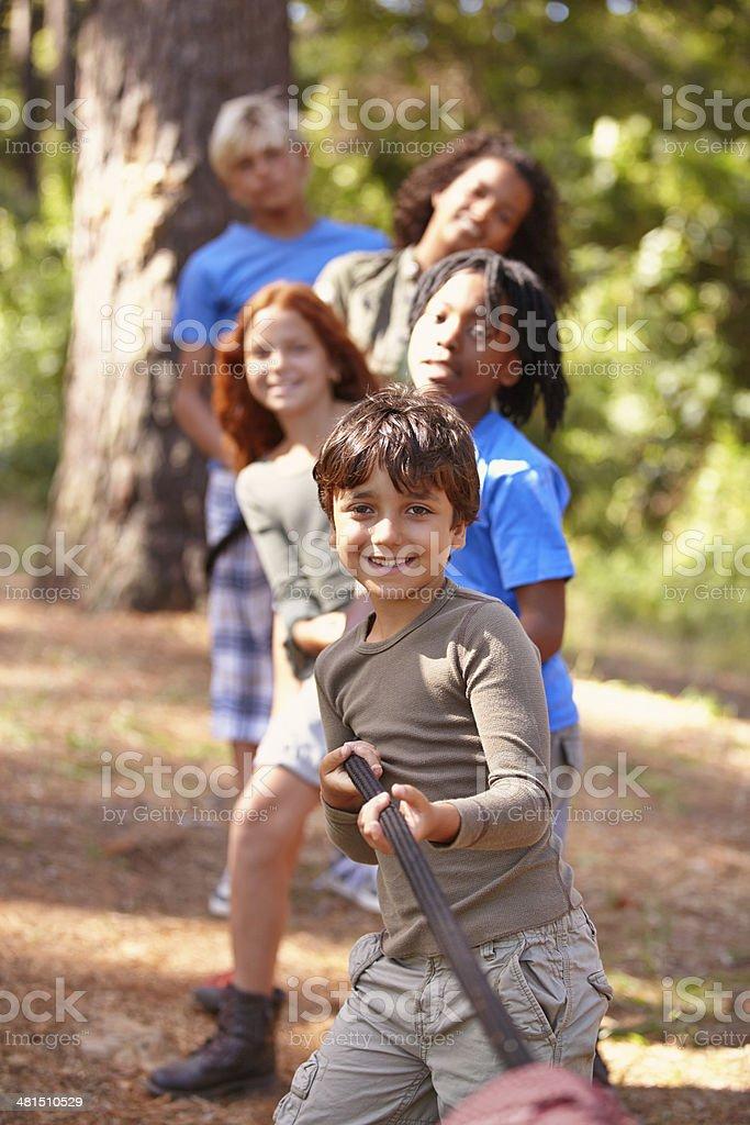 Learning teamwork through play stock photo