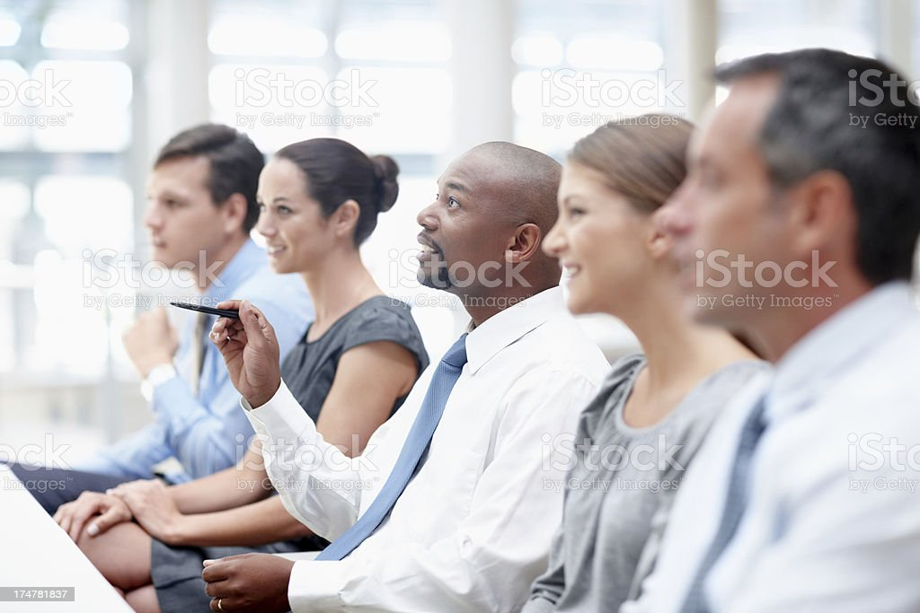 Learning their way to success - Business conference stock photo