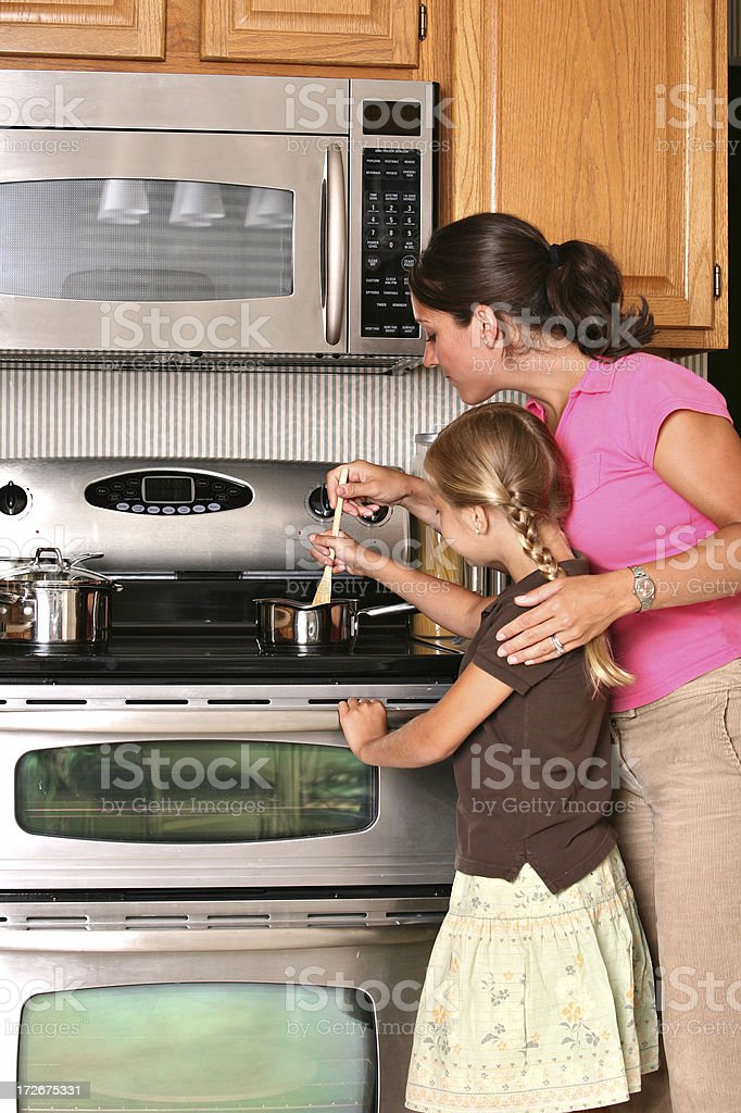 Learning to Cook royalty-free stock photo