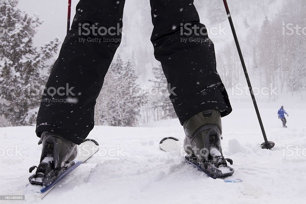 Learning to downhill ski in fresh mountain powder. stock photo