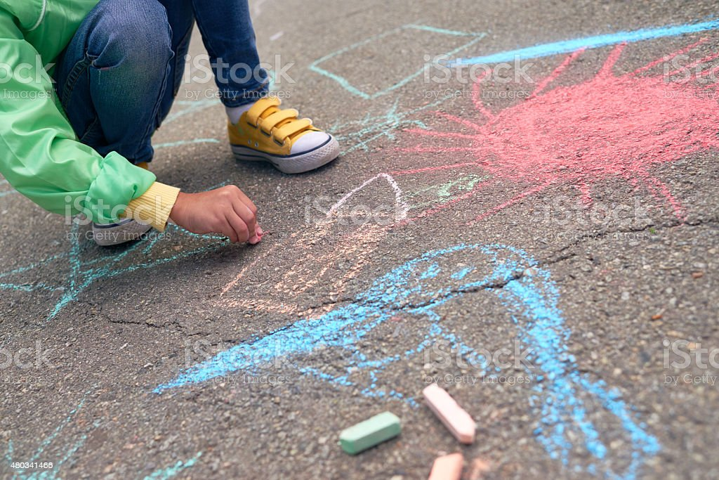 Learning to draw with chalk stock photo