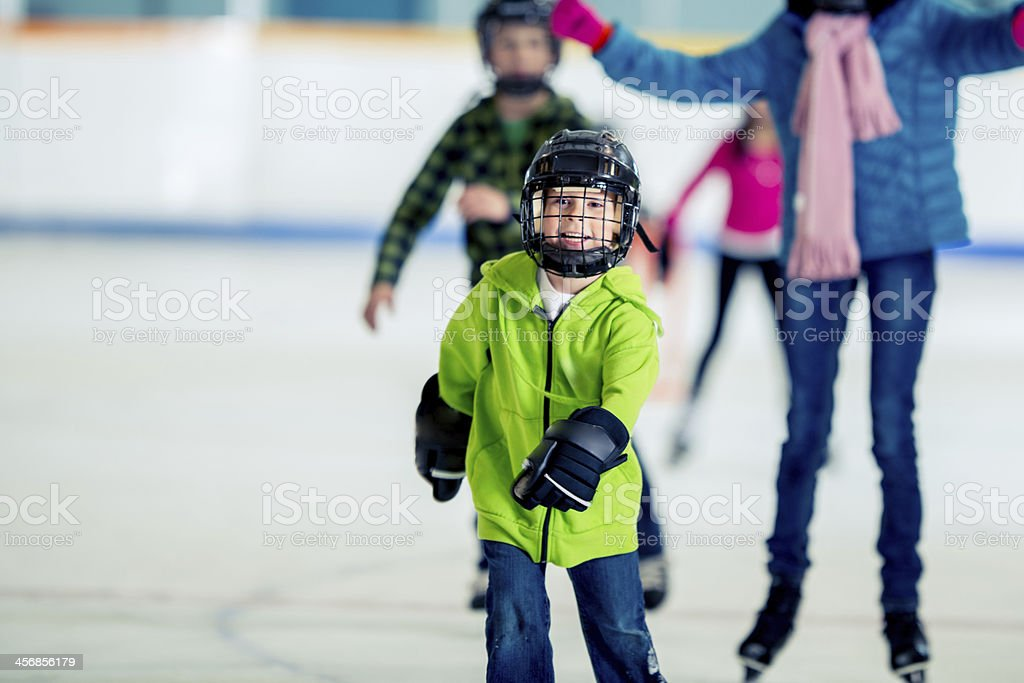 Learning to ice skate. stock photo