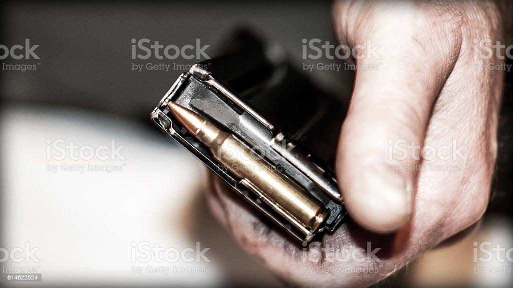 Learning to load gun magazine stock photo