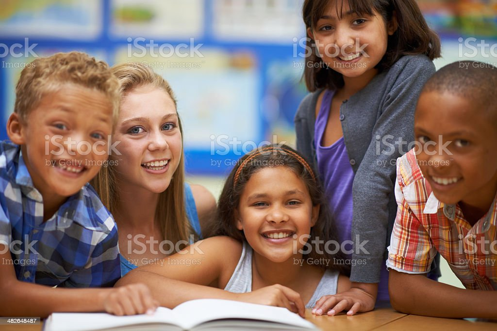 Learning to read and loving it! stock photo
