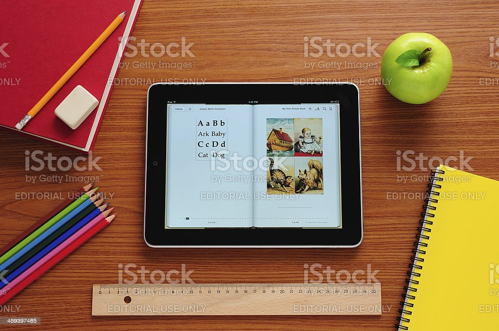 Learning to read with iPad stock photo