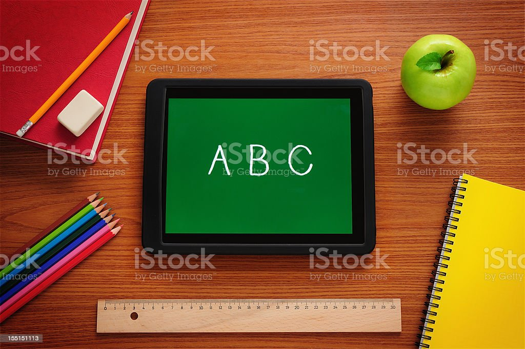 Learning to read with tablet PC stock photo