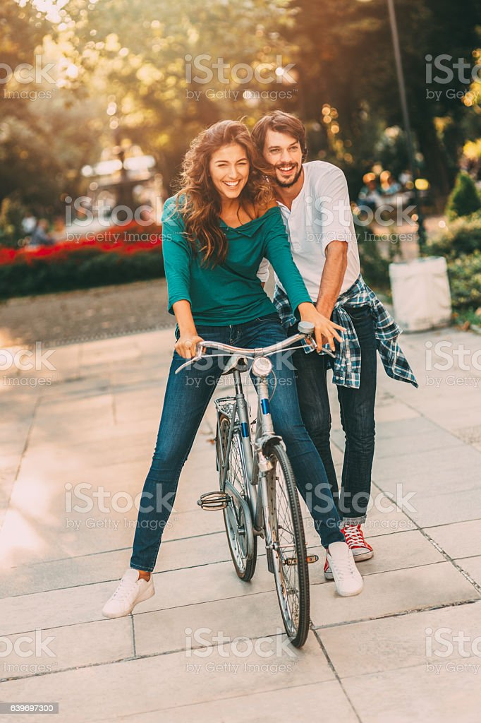 Learning to ride a bicycle stock photo