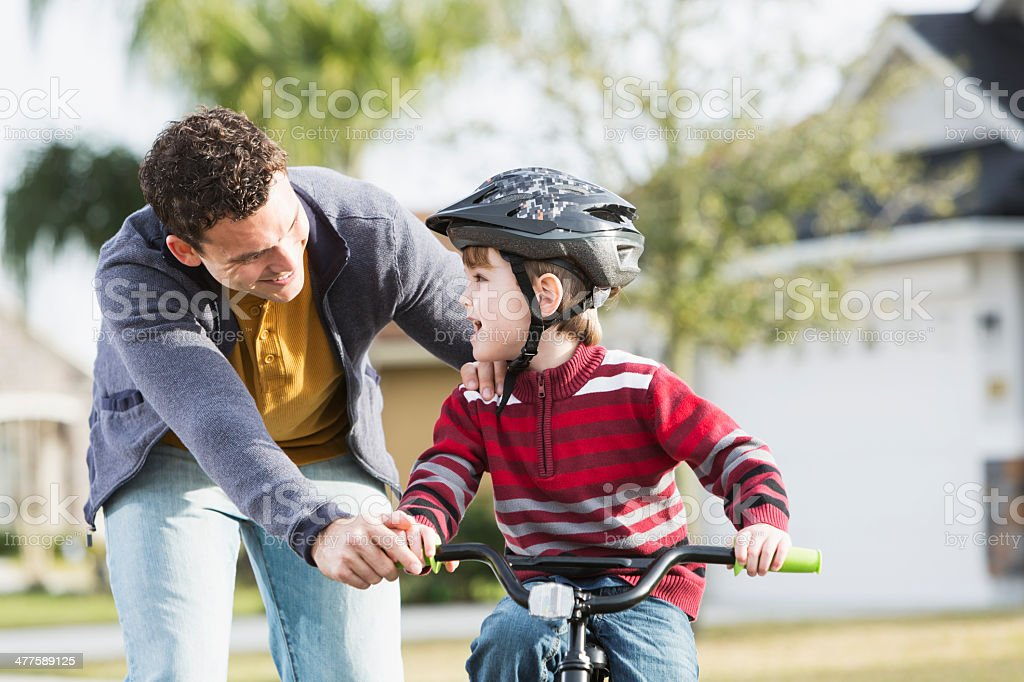 Learning to ride bicycle stock photo