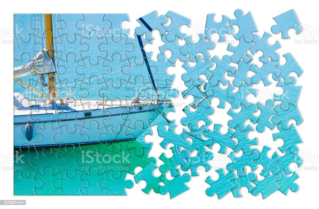 Learning to ride on a sailboat step by step - concept image in puzzle shape stock photo