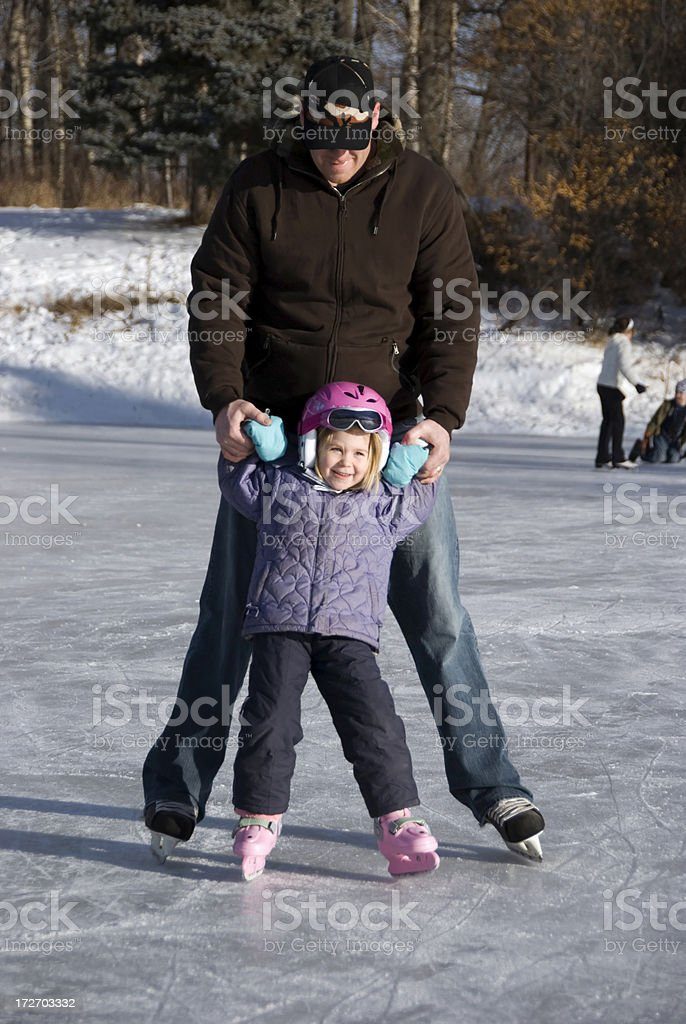 Learning to Skate royalty-free stock photo