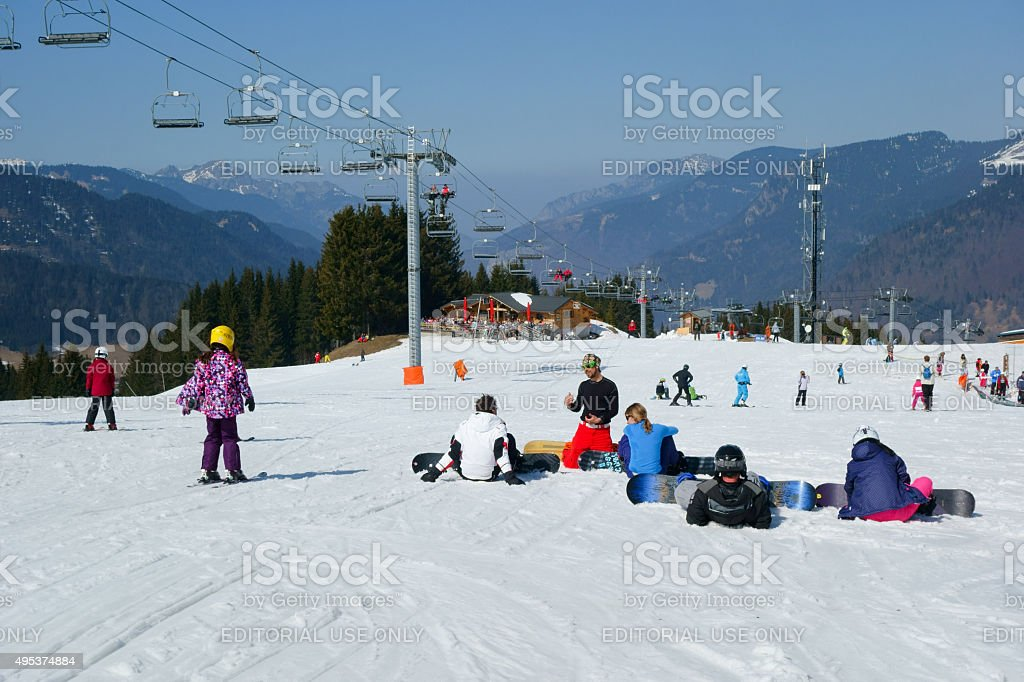Learning to snowboard stock photo