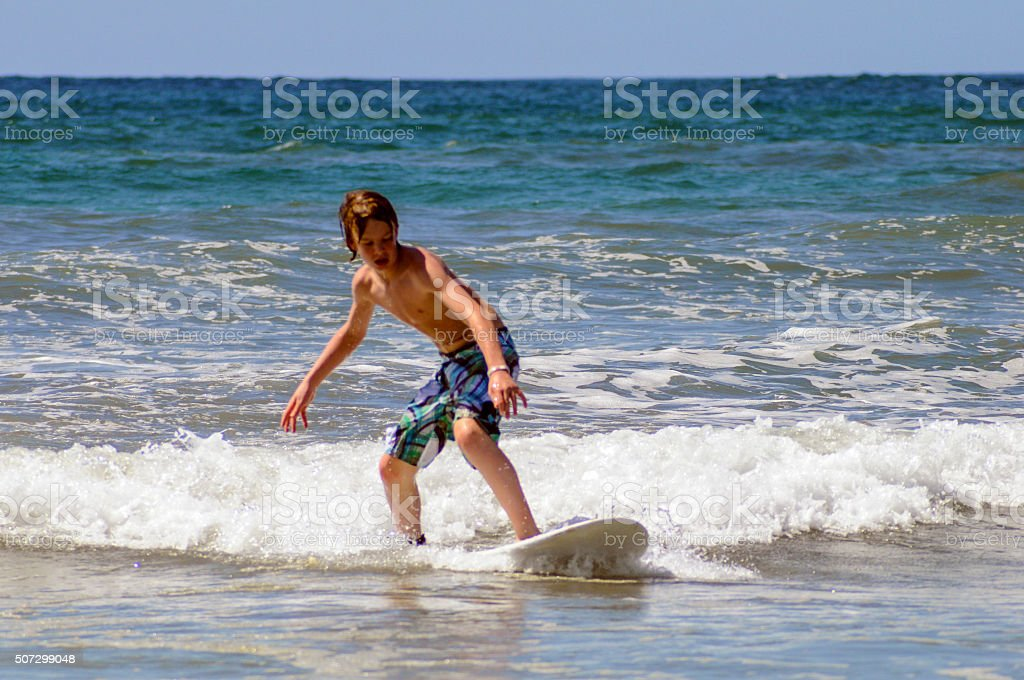 Learning to surf stock photo