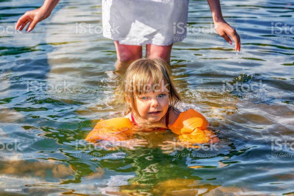 Learning to Swim stock photo