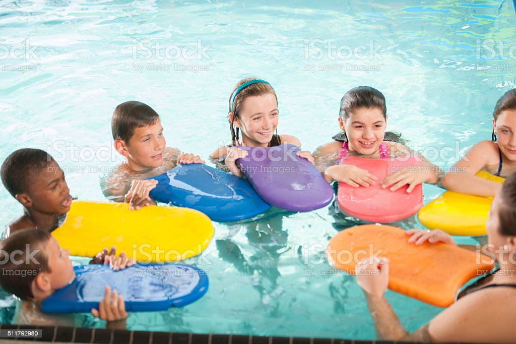 Learning to Swim with Kickboards stock photo