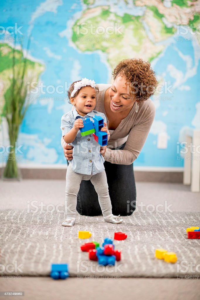 Learning to Walk at Daycare stock photo