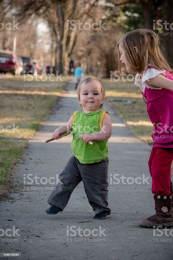 Learning to walk, sister, family stock photo
