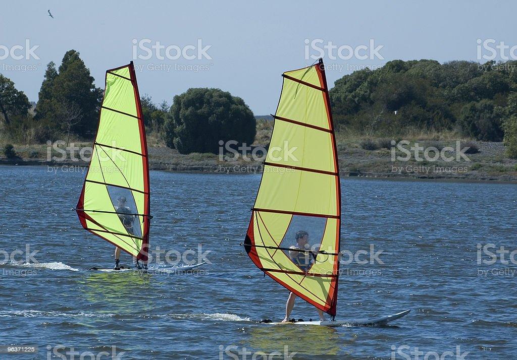Imparare a fare windsurf foto stock royalty-free