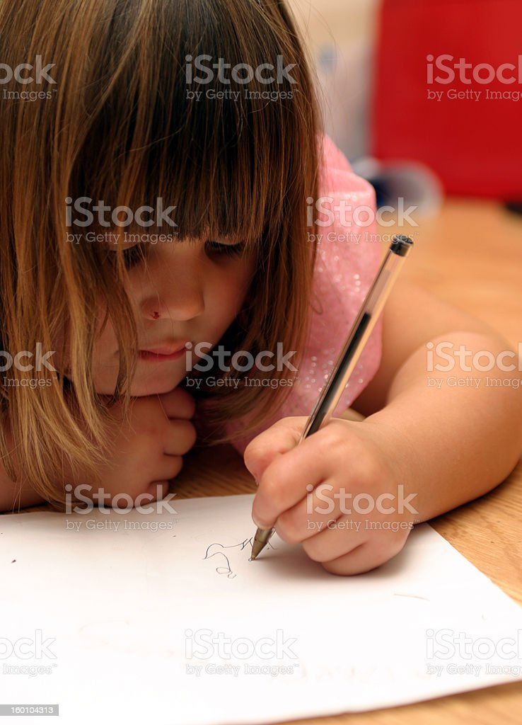 Learning to write left handed royalty-free stock photo