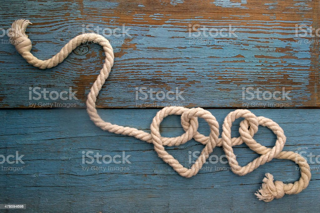 leash  rope into heart shape on wood stock photo