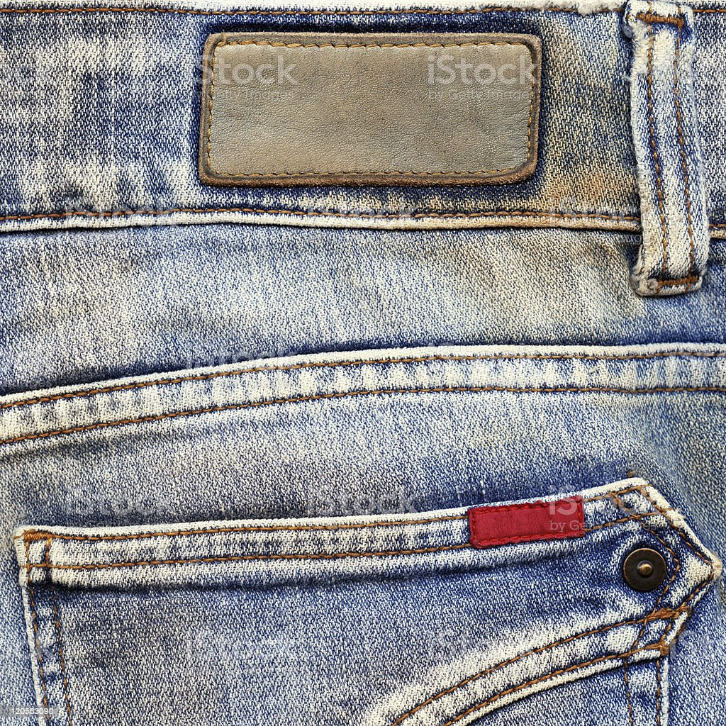 Leather and cotton labels on jeans royalty-free stock photo