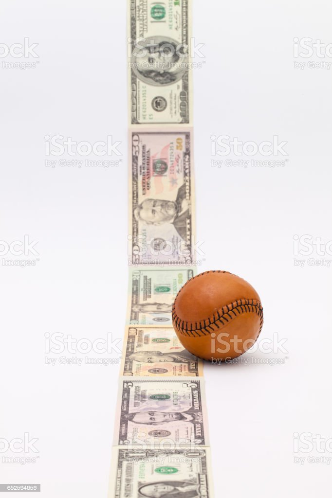 Leather baseball ball and us dollars stock photo