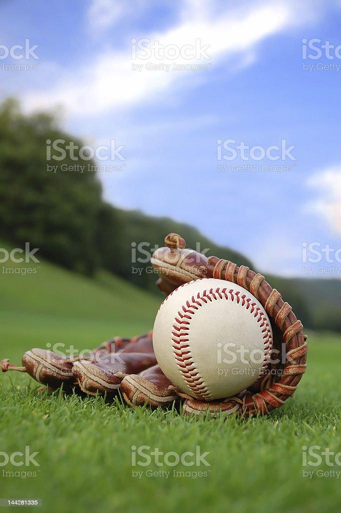 Leather baseball glove holding a baseball ball royalty-free stock photo