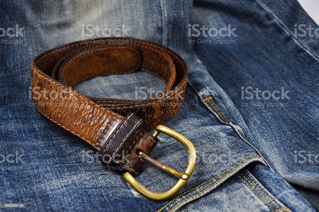 leather belt close-up put on Blue jeans stock photo