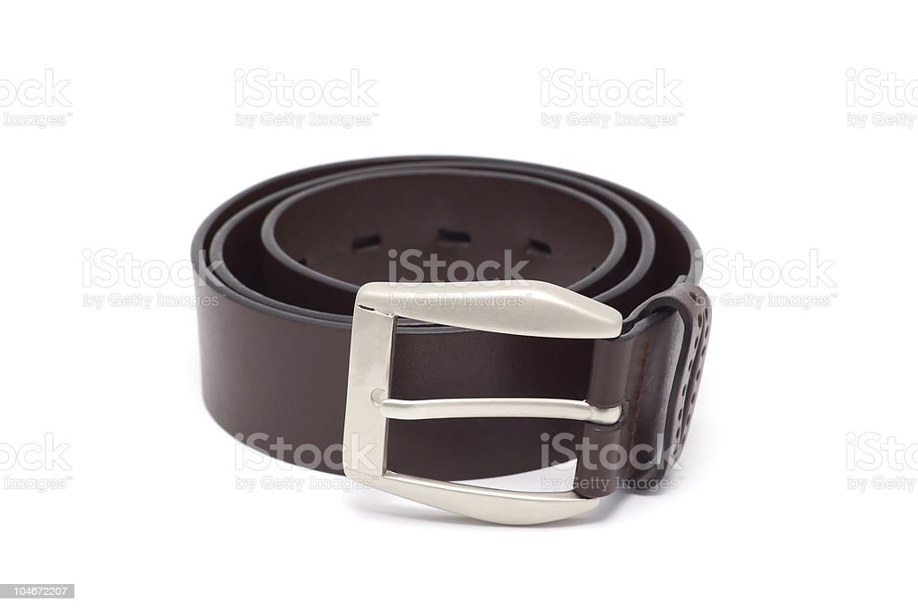 Leather belt with a metal buckle. royalty-free stock photo