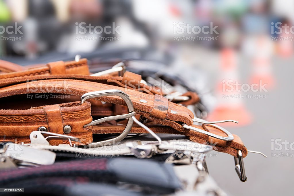 leather belts for cheap sale at a flea market stock photo