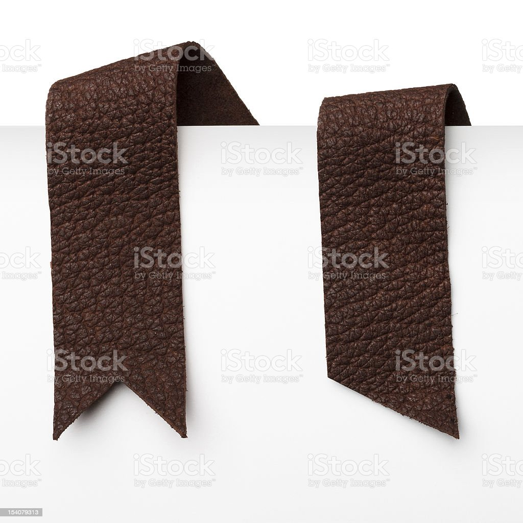 Leather bookmark ribbons stock photo