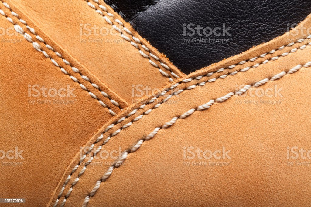 leather boots stitched with thread stock photo