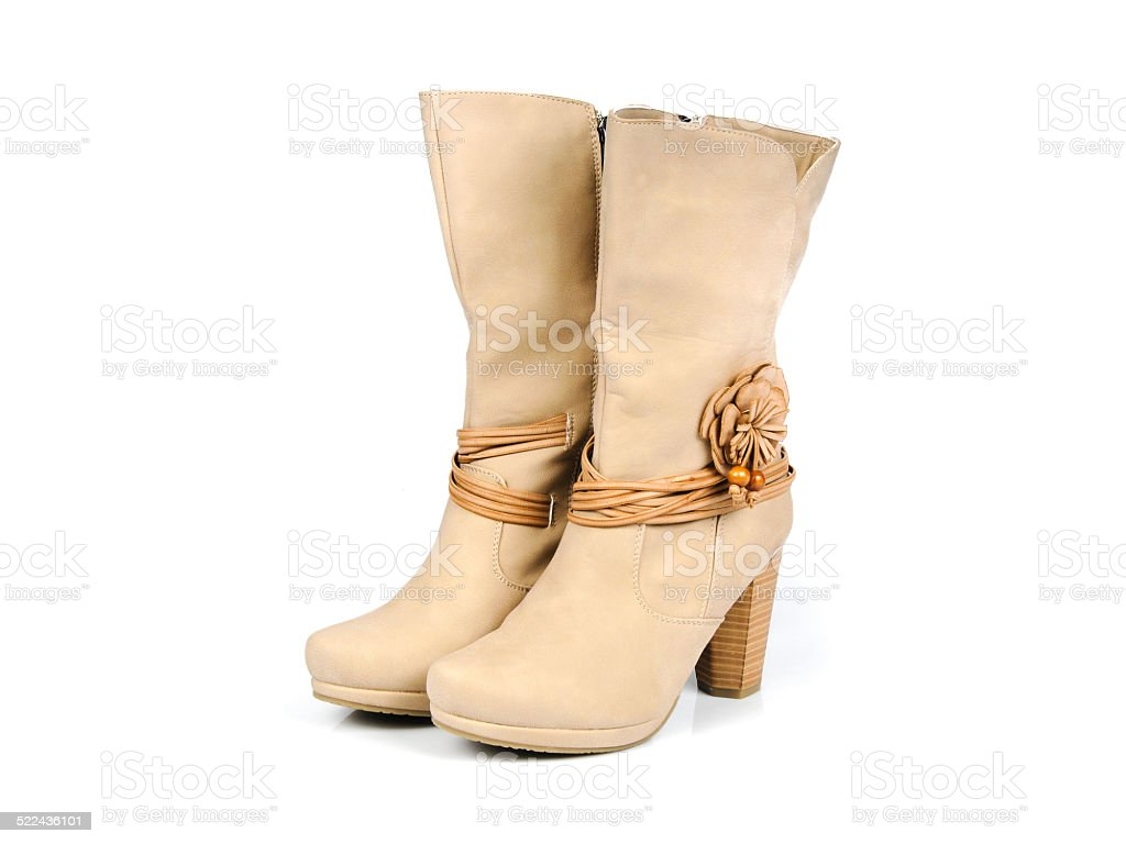 Leather boots with flower and leather strips. Angle View. stock photo