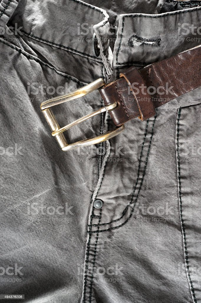 Leather brown belt on gray trousers stock photo