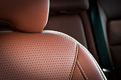 Leather car seats  detail with focus on stitch