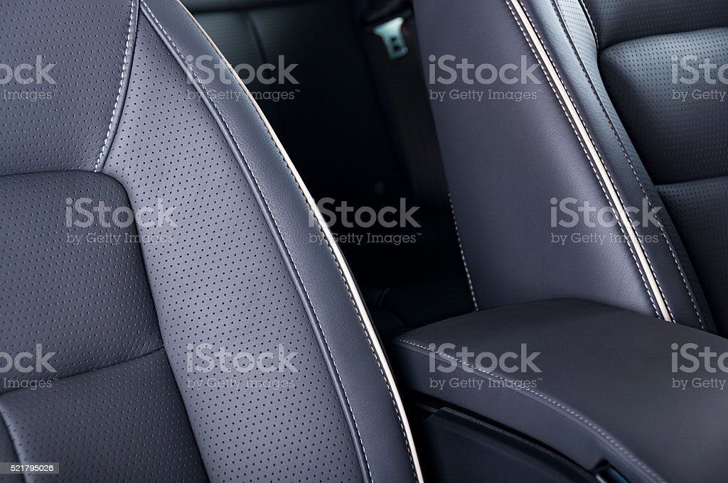Leather car seats  detail with focus on stitch stock photo