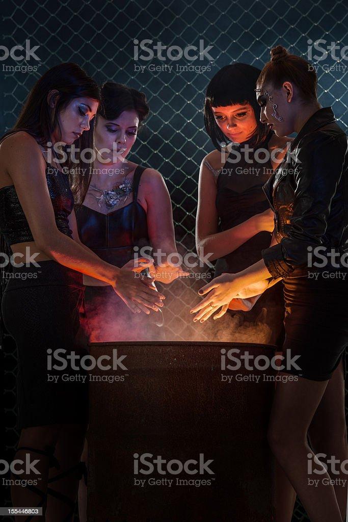 Leather Clad Women Gathered Around Burn Barrel stock photo