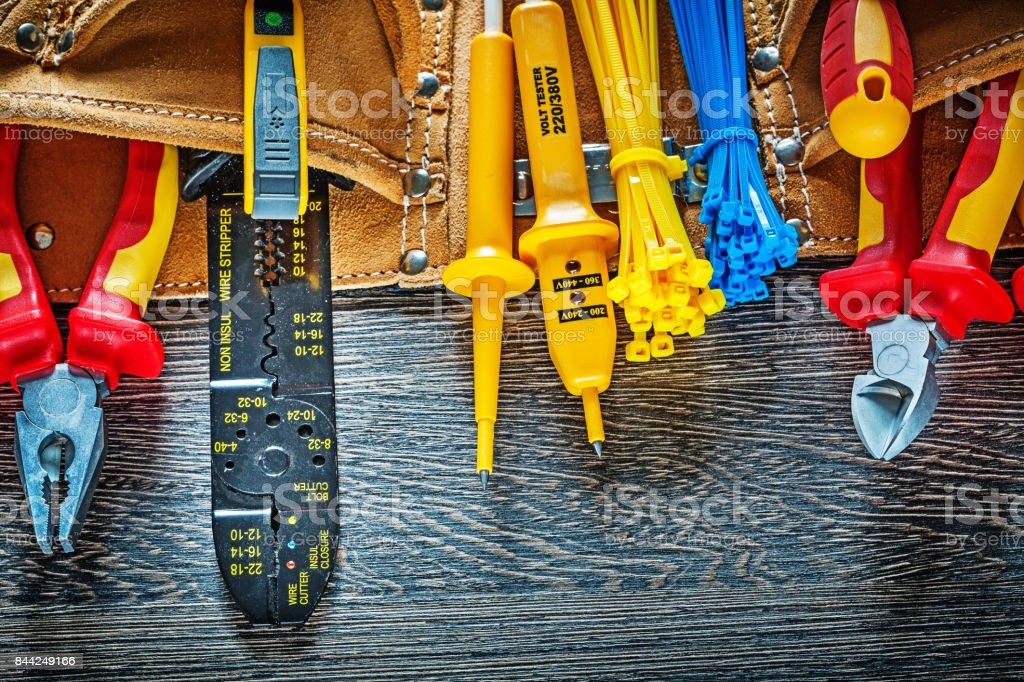 Leather construction belt electrical tools on wood board electri stock photo